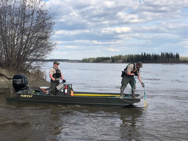 Rangers in boat searching