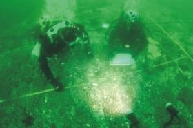 Divers measuring the Kadyak hull timbers