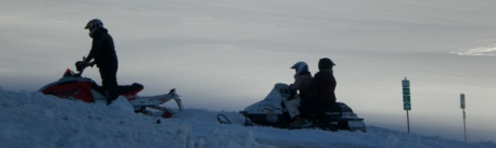 snowmobiles in ice fog